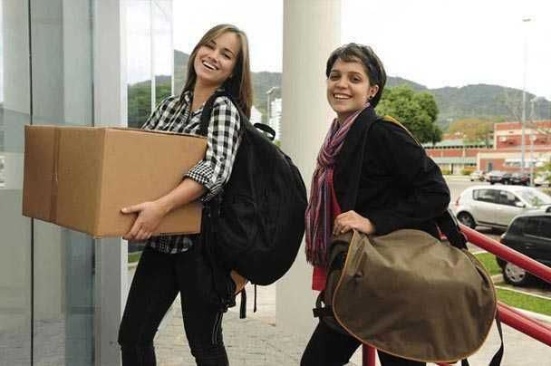 Two college students moving their items ionto their dorm.