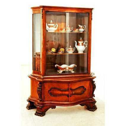 A picture of a elegant china cabinet.